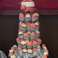 Coral Gerbera Wedding Cake coral pink and white cupcake tower and top cake with sugar flowers