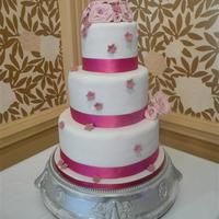 Pink Roses Wedding Cake three tier 5 inch high tiers, with sugar roses and blossoms to represent a cake the bride gave me a pic of but in her colours.