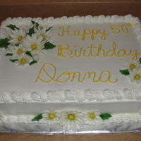 50Th Birthday Vanilla cake with daisies made out of gum paste/fondant