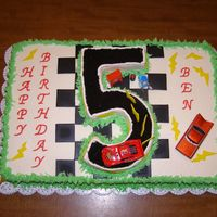 Disney's Cars Vanilla cake w/buttercream frosting. Fondant lightening bolts. The dirt track os made out of crushed oreos (only the cookie, scrap out the...