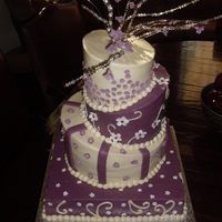 "Purple Topsy Turvy Cake  14"" square and 6'8'10"" cakes of yellow cake filled with fresh strawberries and lemon curd iced with cc icing. accents..."