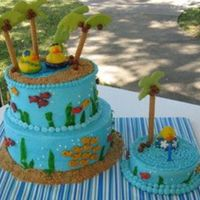 Tropical Luau Cake Buttercream wiith fruit rollups, goldfish, and cereal staws with color flow palm trees.