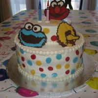 Sesame Street Buttercream with chocolate polka dots and characters.