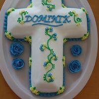 Cross Cake This cake was actually for a baptism. I used the Wilton Cross pan and covered it in MMF and BC accents.