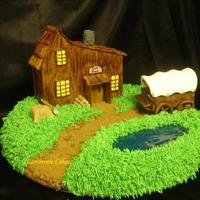 Little House On The Prairie The House and Wagon are made out of fondant with gum-tex added. Both are hand made and painted. The pond is piping gel with a little Karo...