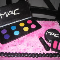 Mac Makeup  I did this cake for a co-worker who loves mac makeup. This cake was alot of fun to do. All pieces are chocolate, and cake is covered in...