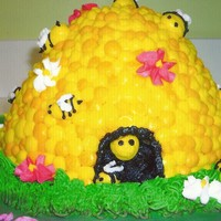 Honeybee Hive  This cake was for a girl at work named Honey. I though the honey bee hive would be a good match then! I used the dress pan for the hive. I...