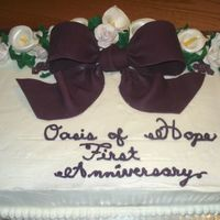 Church Anniversary Cake This is a BC with fondant and gumpaste accents. Loved doing this cake. First time working with the gumpaste ( lilies and roses) had a great...