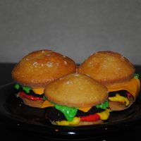 "Cheeseburger Cuppiecakes! I love love love these. So cute and sooo easy to make. The ""buns"" are yellow cupcakes, the ""patties"" are chocolate..."