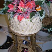 "Mother-In-Law Christmas Birthday  basket of poinsettas (pascuas). 6""and 8"" round vanilla cakes covered with vanilla BC mounted in wood and branches plates. Basket..."