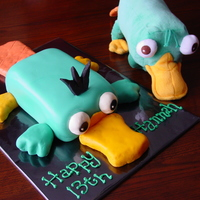 "Perry The Platypus   Everything is covered in fondant...bill, tail, and ""paws"" are molded from Rice Krispies and covered in fondant."