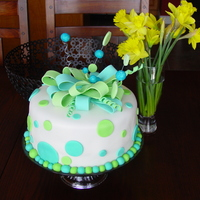 Polka Dots   I always love how classic and timeless the polka dot cakes are. My first attempt at ribbons...I was pleased with the end result.