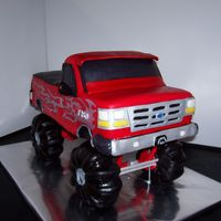 Ford F350 This cake was a Groom's cake. It's a Ford F350 with tribal flames on the sides. The tires are made out of RKT covered with MMF....