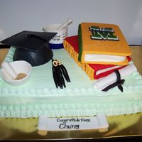 Marshall Graduation This cake was for a Marshall graduate. His degree is in Chemistry. The mortar & pestel, beaker, and cap are all made out of fondant and...