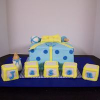 Baby Shower Gift White cake with buttercream and fondant accents. Building block are RKT covered with fondant.