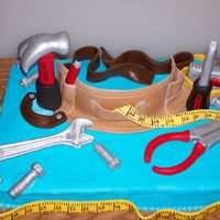 Craftsman Toolbelt Toolbelt and tools are all made out of fondant and gumpaste.