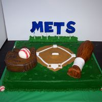 Baseball Baseball glove and ball are cake covered in buttercream. The baseball bat is also cake but it is covered in MMF and painted to give a wood-...