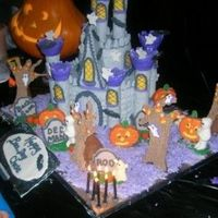 Chase's Boo-Day Cake This was made for my Grandson Chase. The castle cake was covered in grey fondant and the trees were made of chocolate cookies, the...