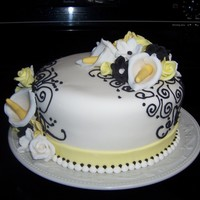 Black, Yellow & White Cutting Cake Cake mad with cala lilies, yellow and white roses, accents with black.