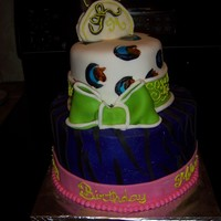 Funky Birthday Cake this 2 tier crzy cake, was made for a fun lovin' lady who loved purple.