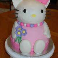 "3D Hello Kitty The base of this cake (wilton wonder mold ontop of 8"" round) was covered in MMF, Hello Kitty's head is BC (wilton ball mold,..."