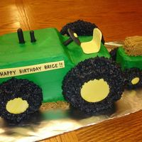 John Deere Tractor This cake is all carved out of pound cake, covered in BC with MMF accents.
