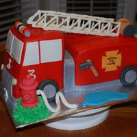 3D Firetruck This was my first firetruck cake. The cake is frosted in BC (customer's request over MMF). All detail is in MMF except the ladder...