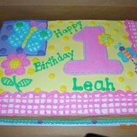 Hugs N Stitches Girls first birthday and I was given the theme to match. All BC icing