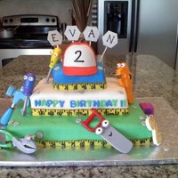 Handy Manny Birthday Cake This is my son's 2nd birthday cake. The cake is covered in MMF (Rhonda's ultimate) with gumpaste hat and measuring tape. I formed...