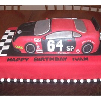 Race Car Birthday Cake  My husband and I made this birthday cake for his boss, who races cars as a hobby. Everything is edible! The car is made from cake and...