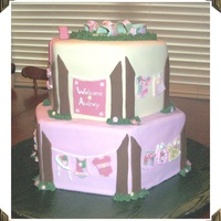 Pink Camo Clothesline Baby Shower Cake  This Pink Camo Clothesline Baby Shower Cake was made for a friend's baby shower. Everything on the cake is edible. The sandals on top...