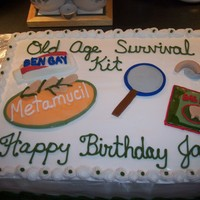 Old Age Survival Kit This cake has a hearing aid, bag balm, magnifying glass, metamucil and ben gay on it. It was for a guy turning 50.