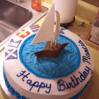Sailing Birthday Birthday cake for a lady who was into sailing. Her first name is spelled out in nautical flags