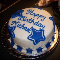 Dallas Cowboys B-Day This is the first time I covered a cake with ganache and then fondant. I was not super impressed with it...........guess I should try again...