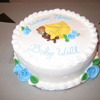 Welcome Home Baby Cake Simple 'welcome home baby' cake. Whipped icing, fondant baby, bear, blanket. Ribbon roses and leaves. Writing needs a little work...