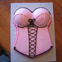 Bridal/lingerie Bustier Cake A 11x15 hand-carved sheet cake with half ball pan for bust. Iced with buttercream, with black accents. Inspired by a cookie I saw on CC.