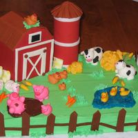 Barnyard Cake  For my son's 2nd birthday - put the #2 candle in the middle of the cake (not shown). Gumpaste fence, silo, barn, and grain sacks (next...