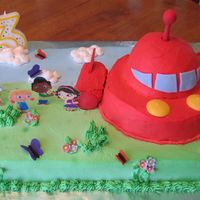 Little Einsteins Birthday Cake 9x13 sheetcake, half ball pan for rocket, and twinkies for the rocket boosters. Whipped icing - so the colors bled together badly. I...