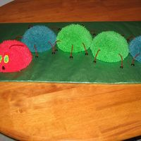 "Very Hungry Caterpillar Cake For a boy's 1st birthday, based on ""the very hungry caterpillar"" book. Five sports ball pan halves make the body, red..."