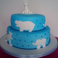 Baby Giraffe, Blue & White Babyshower Cake  2tier (8inch red velvet cake, vanilla filling, 10in white cake, strawberry mousse filling)Jungle animals silhoutte along side of both tiers...