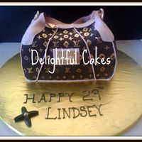 3D Lv Purse Cake   Chocolate fondant covered, vanilla cake with buttercream filling. Hand Painted with super gold & vodka. TFL!