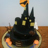 Spooky Creepy Haunted Halloween House  airbrushed black. covered in fondant, all decroations except for the moon and the creepy bare trees and the castle are made of fondant. the...