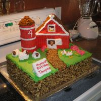 Barn Cake I am so proud of this cake I have other pictures of just the animals. Everything was piped and I used no special pans. The silo is cookies...
