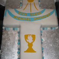 First Communion Cake White cake with ferrero rocher filling and all fondant decorationsthis was a huge project to tackle ......the board measured 2feet x...
