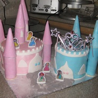 Disney Princess Theme Cake yellow cake filled with nutella buttercream covered in fondant...the picture is not the greatest but the front shows a cobble stone path...