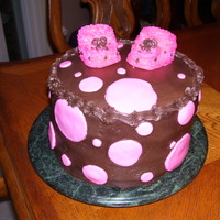 Baby Shower Cake Strawberry cake with strawberry filling with dark choc. buttercream. Cupcake & buttercream booties. First attempt at the booties but...