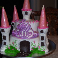 Audrie's Castle WASC, w/ cookies & cream filling, buttercream frosting & most decorations. Rolled buttercream wrapped ice cream cones for turret...