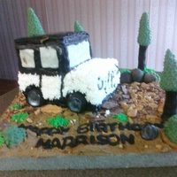 Jeep B-Day For a first birthday, sugar-free apple cake stacked and carved into a jeep. Trees and rocks made out of fondant. So much fun to make!