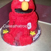 Elmo Birthday Cake Elmo is made from pound cake. Eyes, nose, arms and legs are rice treats. Butter creamwith fondant accents. Made for my daughters 3rd...