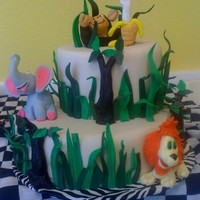 Jungle Theme Little boy's 1st birthday. Animals out of modeling chocolate, everthing else fondant. Elephant's tusk, lion's tail, and of...
